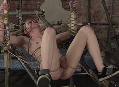Tied near slave Leo receives his nuisance drilled by horny Deacon